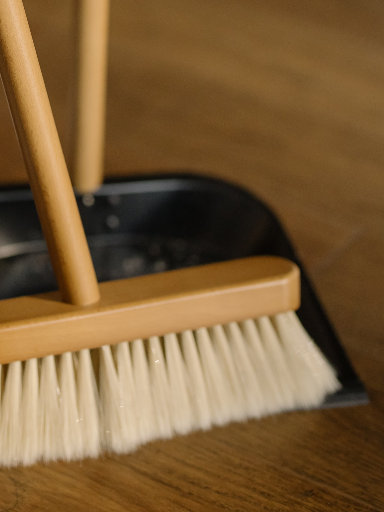 brown-wooden-brush-on-black-plastic-container-4108714
