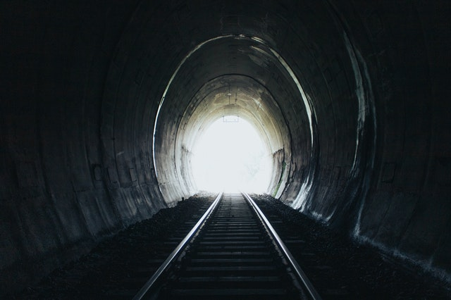 tunnel-with-black-railway-Photo by Jakson Martins from Pexels